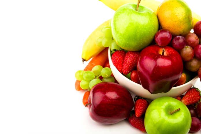 Fresh fruit on plate Isolated on white